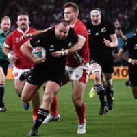 New Zealand's Joe Moody scores a try against Wales in the first half. | AFP-JIJI
