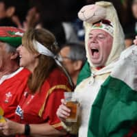 Wales supporters cheer during the bronze-medal match against New Zealand at Tokyo Stadium on Friday night. | AFP-JIJI