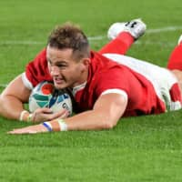 Hallam Amos scores Wales' first try in the 19th minute. | AFP-JIJI