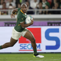 South Africa's Makazole Mapimpi scores a try in the second half against England in the Rugby World Cup final on Saturday night at International Stadium Yokohama.   AP