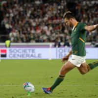 South Africa's Handre Pollard kicks a penalty in the first half of the Rugby World Cup final on Saturday.   AP