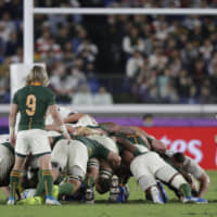 Referee Jerome Garces resets a scrum during the Rugby World Cup final.   AP