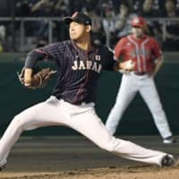 Japan southpaw starter Shota Imanaga pitches against Canada in an exhibition game on Friday night at Okinawa Cellular Field. Japan defeated Canada 3-0. | KYODO