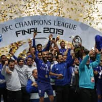 Al Hilal celebrates its Asian Champions League title-clinching victory over the Urawa Reds on Sunday night at Saitama Stadium. Al Hilal defeated Urawa 2-0 in the second leg of the ACL final. | AFP-JIJI