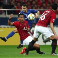 Al Hilal's Abdullah Otayf (rear) clashes with Urawa's Tomoaki Makino during the second leg of the Asian Champions League final on Sunday at Saitama Stadium. | AFP-JIJI