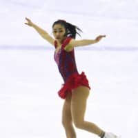 Mana Kawabe skates her short program to 'You're a Mean One, Mr. Grinch,' on Saturday at the Japan Junior Championships. Kawabe leads the women's field with 64.95 points. | KYODO