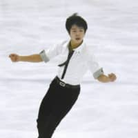 Shun Sato, seen competing in the men's short program on Saturday, is in third place entering the free skate on Sunday. | KYODO