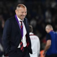 England head coach Eddie Jones smiles after receiving his runner-up medal after the Rugby World Cup final on Saturday in Yokohama. | AFP-JIJI