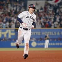 Samurai Japan's Seiya Suzuki rounds the bases in the fourth inning on Monday night in Chiba after hitting a home run against Australia. AP