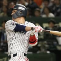 Japan's Hayato Sakamoto drives in a run during the second inning at Tokyo Dome. | KYODO