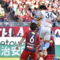 Frontale's Kazuya Yamamura scores on a header in the 62nd minute against the Antlers on Saturday at Kashima Stadium. Kawasaki defeated Kashima 2-0. | KYODO