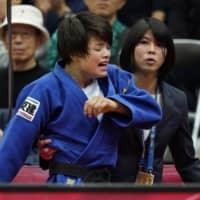 Uta Abe reacts after losing the women's 52-kg final of the Osaka Grand Slam on Friday at Maruzen Intec Arena Osaka. | KYODO