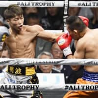 Naoya Inoue (left) and Nonito Donaire square off in the first round of the World Boxing Super Series bantamweight final on Thursday night at Saitama Super Arena. | KYODO