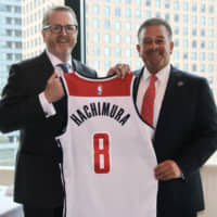 Wizards part owner Raul Fernandez (right) and president Jim Van Stone hold a Rui Hachimura jersey on Tuesday during a visit to Tokyo by team executives. | KAZ NAGATSUKA