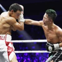 Takuma Inoue (right) and Nordine Oubaali exchange punches in the 10th round of their WBC bantamweight title fight on Thursday night. | KYODO