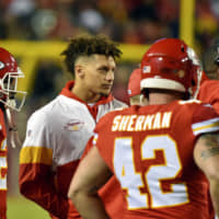 Kansas City Chiefs QB Patrick Mahomes, seen here in street clothes during last month's game against Green Bay, practiced fully Wednesday for the first time since dislocating his knee. | AP