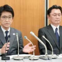 Japan Tennis Association executive Tsuyoshi Fukui (left), seen in a May 2017 file photo, also serves as the Japanese Olympic Committee secretary general. | KYODO