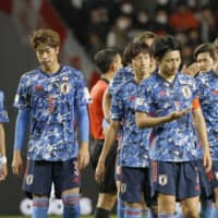 Samurai Blue players react after their 4-1 loss to Venezuela on Tuesday night in Osaka. | KYODO