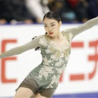 Rika Kihira performs her free skate routine at the NHK Trophy on Saturday en route to a second-place finish. | KYODO