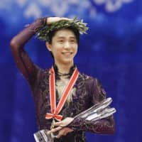 Yuzuru Hanyu holds his trophy after winning the men's title at the NHK Trophy on Saturday. | KYODO