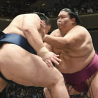 Sekiwake Mitakeumi (right), coming off his second championship with a 12-3 record at the Autumn Grand Sumo Tournament in Tokyo in September, is seeking promotion to ozeki at the Kyushu Basho in Fukuoka. | KYODO