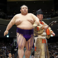 Takakeisho won promotion back to ozeki with 12 wins but suffered a pectoral injury during his championship playoff loss to Mitakeumi on the last day of the Autumn Basho. | KYODO