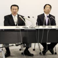 All Japan Taekwondo Association President Noboru Kanehara (left) speaks at a news conference on Wednesday. An outside panel chose not to reappoint Kanehara to the position after athletes protested in a call for reforms. | KYODO