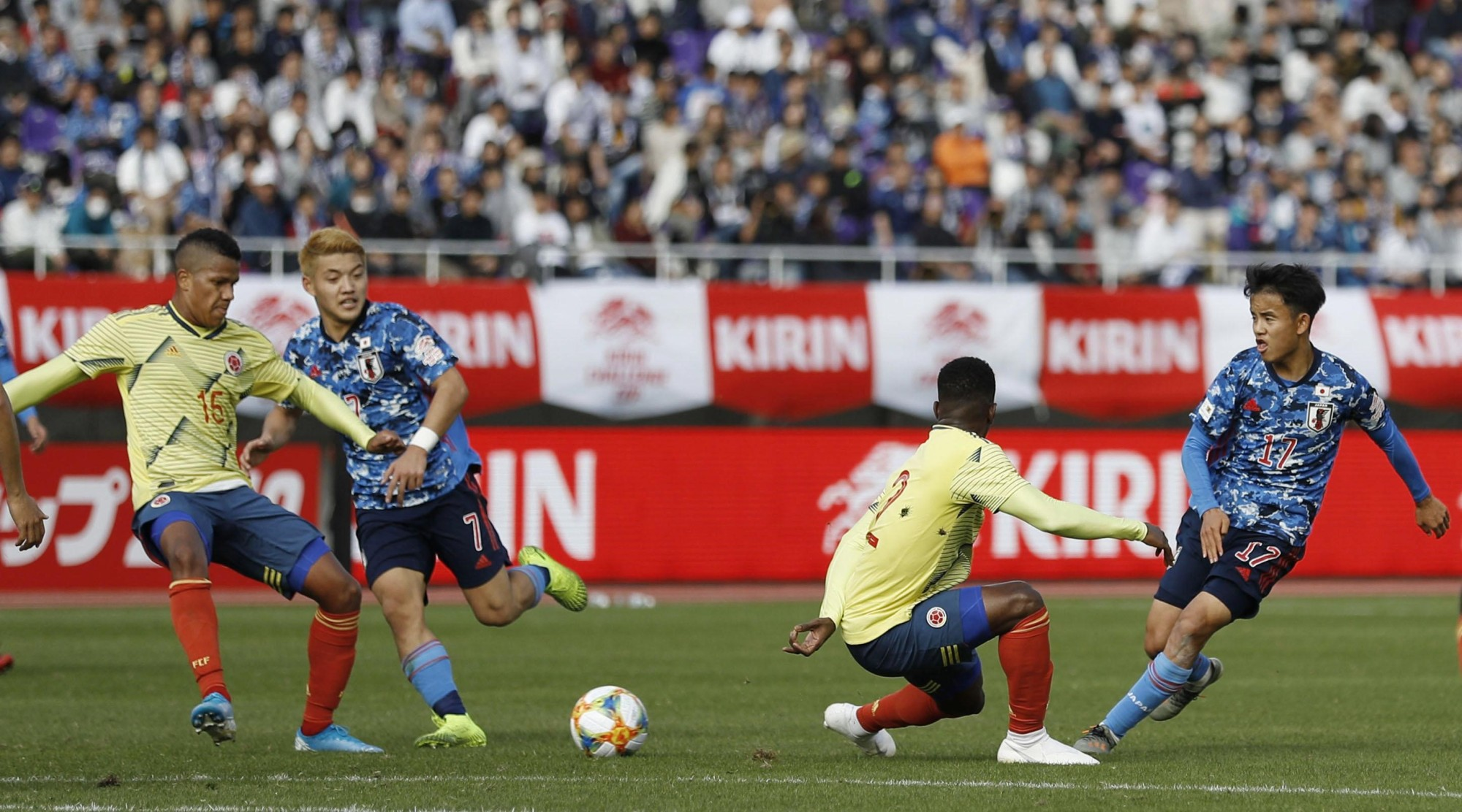 Takefusa Kubo (right) passes to Ritsu Doan (second from left) during an under-22 friendly between Japan and Colombia on Sunday in Hiroshima. | KYODO