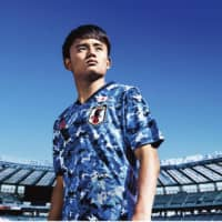 Takefusa Kubo models the new Japan national team uniform for Adidas. | KYODO