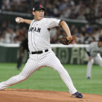 Giants pitcher Shun Yamaguchi, seen in action for Samurai Japan during the Premier12 final on Sunday at Tokyo Dome, will attempt to move to MLB via the posting system this offseason. | AP