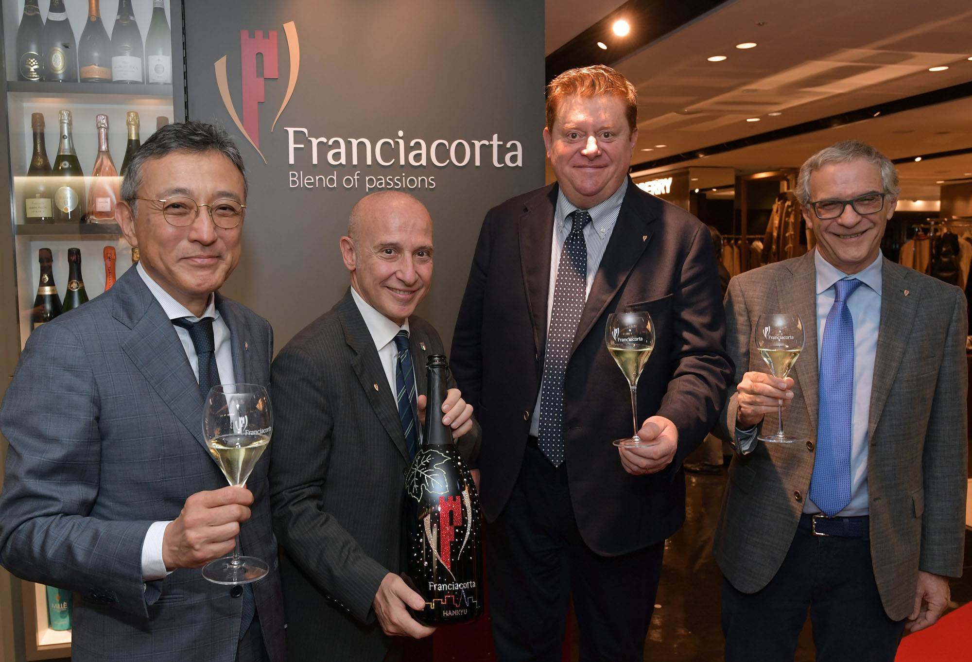 The new Chairman of the Franciacorta Association Silvano Brescianini (second from right) with, from left, Director and Managing Executive Officer of Hankyu Hanshin Department Store Co. Ltd.Norifumi Morii, Ambassador of Italy to Japan Giorgio Starace and Franciacorta Association CEO Giuseppe Salvioni during a ceremony to welcome the new chairman at Hankyu Men's Tokyo on Nov. 19. | YOSHIAKI MIURA