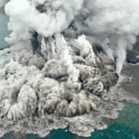 The December 2018 volcanic eruption that triggered a tsunami in Indonesia. | KYODO