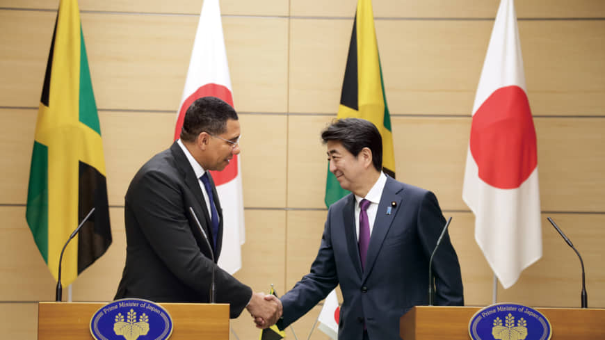 Jamaican Prime Minister Andrew Holness and Japanese Prime Minister Shinzo Abe at their joint press briefing in Tokyo last month.