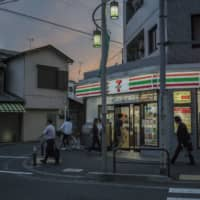 A long-running error in Seven-Eleven Japan's calculations for part-time workers led to an overtime payment shortfall. | BLOOMBERG