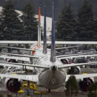 Grounded Boeing Co. 737 Max airplanes are seen parked in a lot near Boeing Field in Seattle last week.   BLOOMBERG