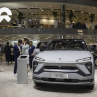 The NIO Inc. ES6 electric sport utility vehicle is displayed at the Auto Shanghai 2019 show in Shanghai in April. | BLOOMBERG