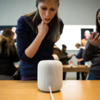 Siri responds to speech during a demonstration of the Apple HomePod at an Apple Inc. store in New York in February 2018. | BLOOMBERG