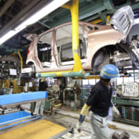 Falling output and retail sales signal Japan's economic strains