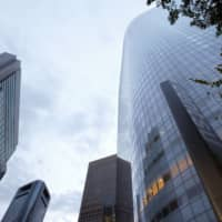 Dentsu Inc. headquarters (right) in Tokyo | BLOOMBERG