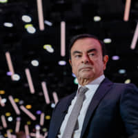 Carlos Ghosn, former chairman of Nissan Motor Co., pauses during a Bloomberg Television interview at the Paris Motor Show on Oct. 2, 2018. Ghosn, who was on bail, fled Japan and arrived in Lebanon on Monday. | BLOOMBERG