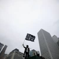 Hong Kong protests cause economy to shrink in fourth quarter