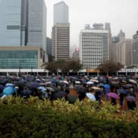 People attend an anti-government rally at Edinburgh Place in Hong Kong Sunday. | REUTERS