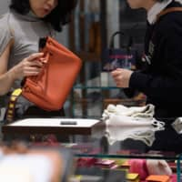 Household spending takes 5.1% dive as Japanese tighten purse strings after tax hike