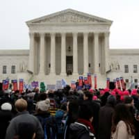 Demonstrators in favor of Obamacare gather at the Supreme Court building in Washington in 2015. | REUTERS