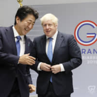 British leader Boris Johnson and Prime Minister Shinzo Abe are pictured ahead of their talks on the sidelines of a Group of Seven summit in Biarritz, southwestern France, on Aug. 26. | POOL / VIA KYODO