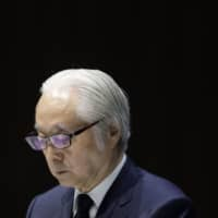 Masatsugu Nagato, president and CEO of Japan Post Holdings Co., pauses during a news conference in Tokyo on July 31. | BLOOMBERG