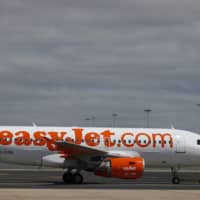 An Easyjet plane is seen at Lisbon's airport in 2016. | REUTERS