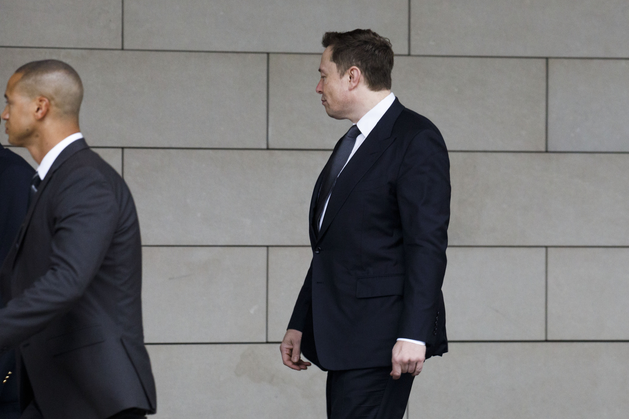 Elon Musk, chief executive officer of Tesla Inc., arrives to federal court in Los Angeles on Wednesday. British caver Vernon Unsworth sued Musk after the chief executive officer of Tesla and SpaceX referred to him as a 'pedo guy' on Twitter. | BLOOMBERG