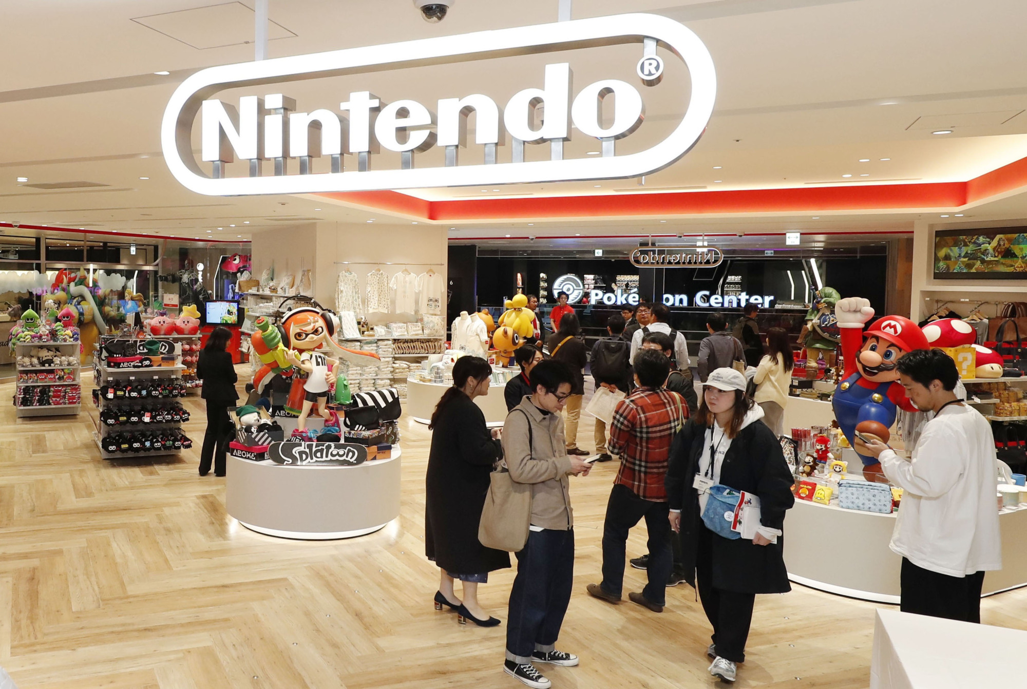 People browse at Nintendo's flagship store in Tokyo's bustling Shibuya district last month. | KYODO