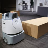 SoftBank Corp.'s industrial cleaning robot Whiz can clean around 1,500 square meters of floor space with one single charge. | KYODO